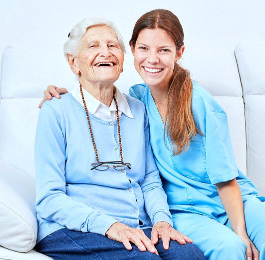 caregiver smiling with female senior