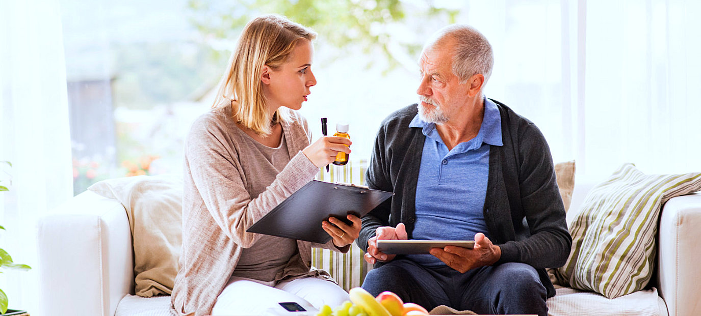 woman talking with senior male