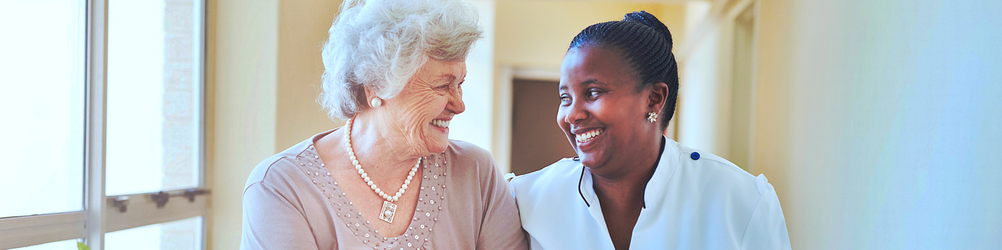 senior woman smiling with nurse
